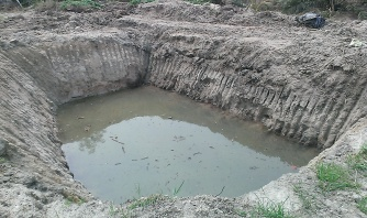 A pond was created by a digger without using concrete or liner. The pond is very deep but I am not sure the exact depth because it was already filled when I saw it.