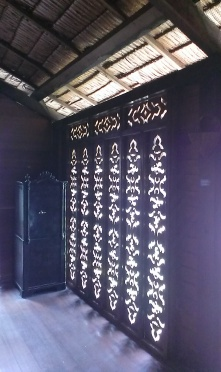 Artistic engravings on the walls to let in the breeze while filtering the glare.