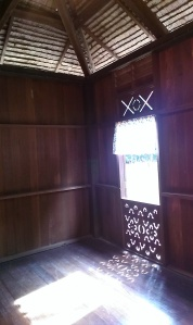 Full-length window in a Malay house.