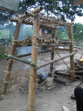 A multi-functional bamboo structure to be placed over the fire for cooking, smoking/drying food, drying seeds, drying clothes, etc.
