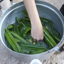Preparing to cook the nasi lemak