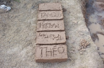 Write your name for fun, but futile because it will be covered up by mortar when building......