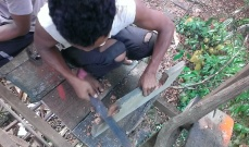 Chopping the wood to shape around pillars or trunks.