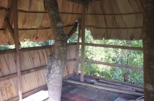 A thatched roof on one side for some privacy from the walkway below.